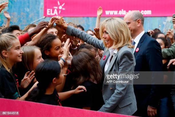 Brigitte Macron the wife of the French president is greeted by children as she attends the 14th dictation exercise event by organised by ELA on...