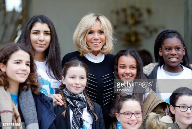 Brigitte Macron the wife of the French president poses with a group of children accompanied by the United Nations' agency United Nations Children's...