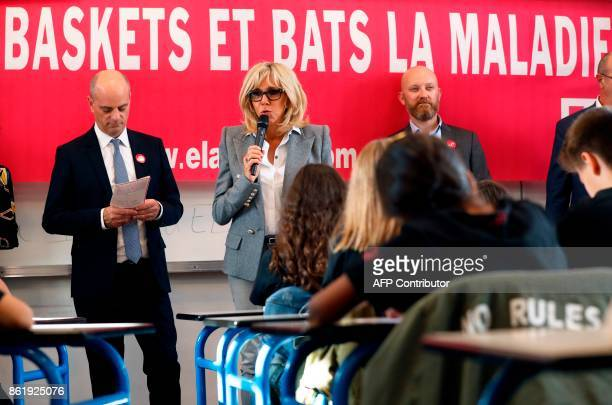 Brigitte Macron the wife of the French president reads a dictation exercise flanked by French Education Minister JeanMichel Blanquer during the 14h...