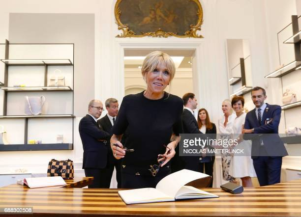 Brigitte Macron wife of French President arrives to sign a guestbook during a visit of the First Ladies to a shop of Belgian fashion label Delvaux on...
