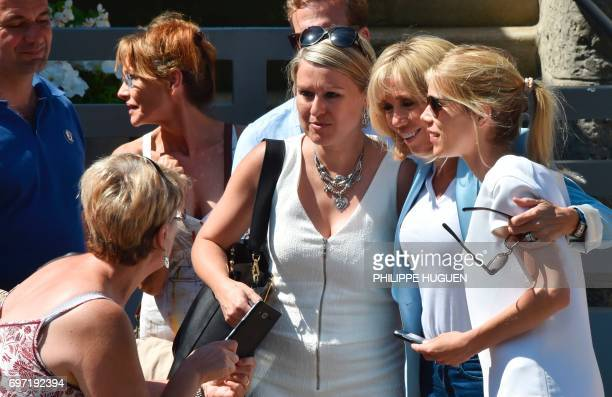 Brigitte Macron wife of French President Emmanuel Macron and her daughter Tiphaine Auziere pose with people on June 18 2017 in Le Touquet northern...