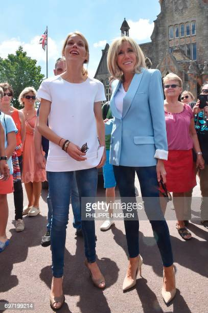 Brigitte Macron wife of French President Emmanuel Macron and her daughter Tiphaine Auziere pose as they leave a polling station after voting for the...