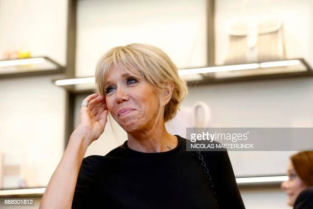 Brigitte Macron wife of French President is pictured during a visit of the First Ladies to a shop of Belgian fashion label Delvaux on May 25 in...