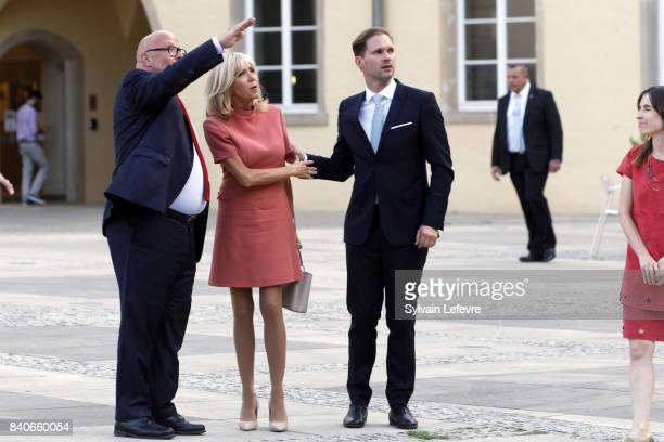 Brigitte MacronTrogneux France's first lady Luxembourg Prime Minister's husband Gauthier Destenay visit Luxembourg's Neumunster Abbey during a one...