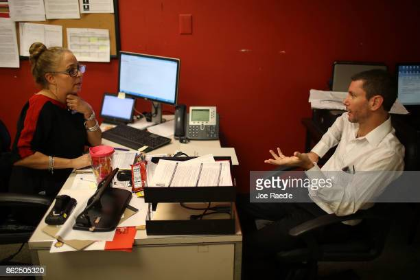 Brigitte Mallesch interviews David McPeck for a seasonal job during a job fair at the JC Penny department store in the Dadeland Mall on October 17...