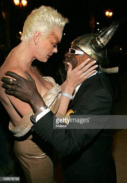 Brigitte Nielsen and Flavor Flav during VH1 Big in '04 Red Carpet at Shrine Auditorium in Los Angeles CA United States