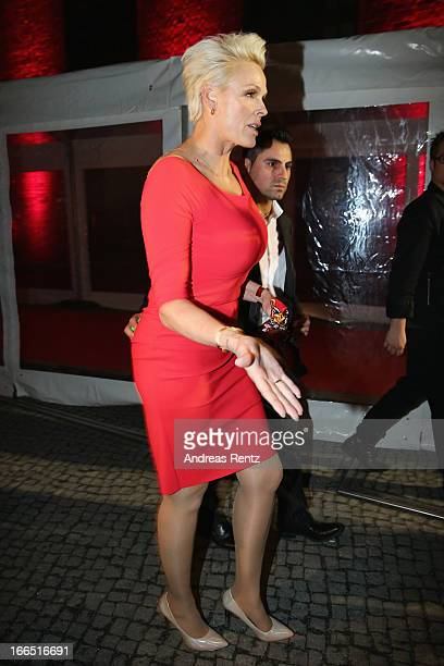 Brigitte Nielsen and her husband Mattia Dessi leave the Jaguar FType short film 'The Key' Premiere at eWerk on April 13 2013 in Berlin Germany