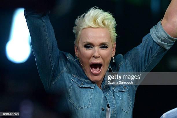 Brigitte Nielsen reacts after winning the final of the television show 'Ich bin ein Star lasst mich wieder rein' on August 8 2015 in Huerth Germany