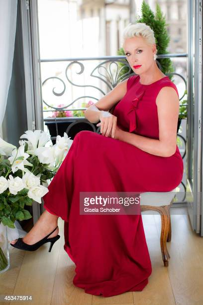 Brigitte Nielsen wearing a dress of Basler poses during a portrait session on July 6 2014 in Milan Italy