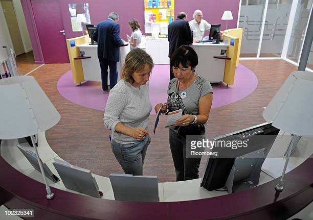 Brigitte Olive a Pole Emploi employee right assists a jobseeker at an unemployment office in Boulogne near Paris France on Wednesday June 23 2010...