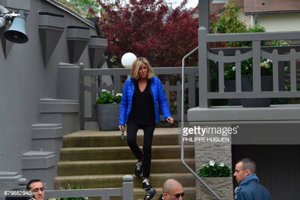 Brigitte Trogneux the wife of French presidential election candidate for the En Marche movement Emmanuel Macron leaves the house as people gather in...