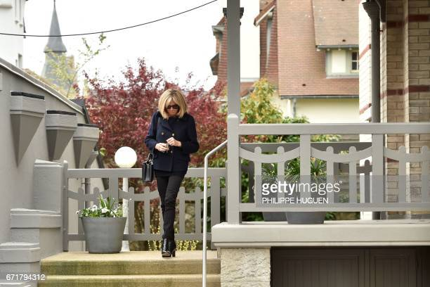 Brigitte Trogneux wife of French presidential election candidate for the En Marche movement Emmanuel Macron leaves their house after voting in Le...