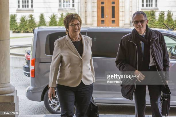 Brigitte Zypries Germany's economy and energy minister left walks Carlos Tavares chief executive officer of PSA Group as he arrives for talks at the...