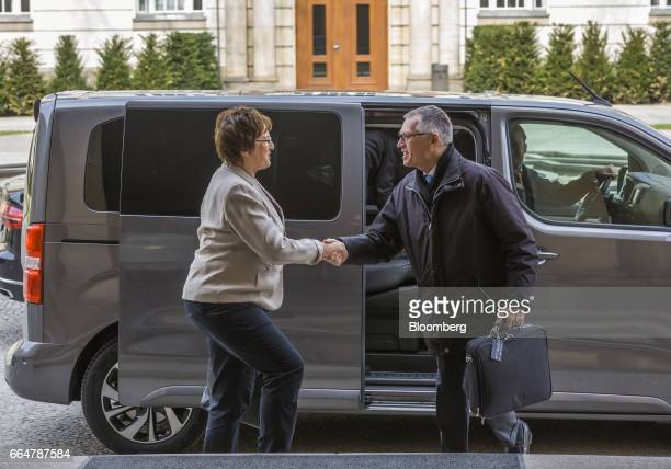 Brigitte Zypries Germany's economy and energy minister left welcomes Carlos Tavares chief executive officer of PSA Group as he arrives for talks at...
