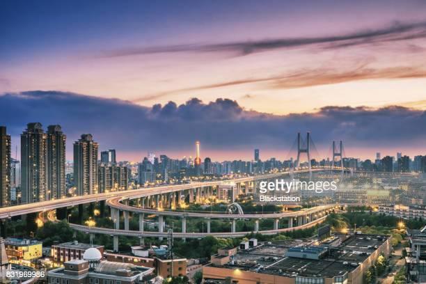 brilliantly illuminated scene of the Nanpu Bridge in Shanghai