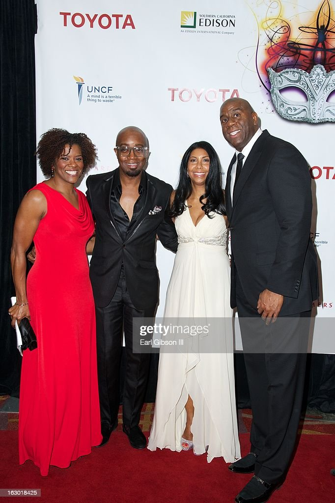 Brinell Slocumb, Jonathan Slocumb, Cookie Johnson and Earvin 'Magic' Johnson attend the UNCF Mayor's Masked Ball Hosted By Mayor Antonio Villaraigosa at Hilton Universal City on March 2, 2013 in Universal City, California.