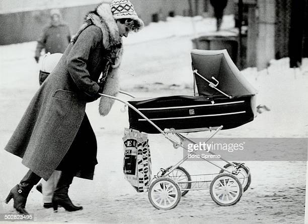 Bringing home the rations A Polish mother pushes her baby carriage through windswept streets toting the large bag that most Poles carry in hopes that...