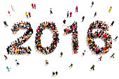 Large group of people in the shape of 2016 celebrating a new year concept on a white background. Vertical version also available.