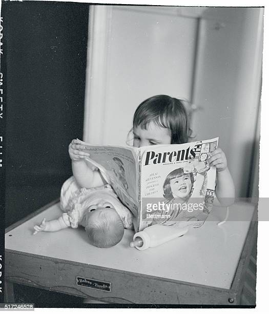 Bringing up parents New York Catching up on the latest methods for handling her folks 23 month old Susan O'Brien of Brooklyn studies an issue of...