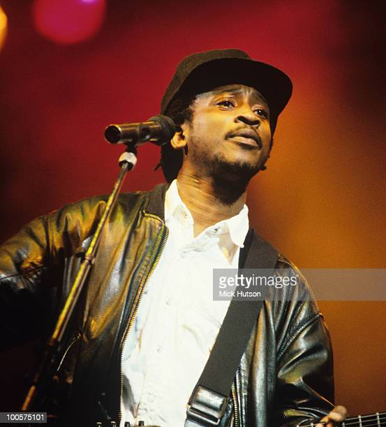 Brinsley 'Dan' Forde of reggae band Aswad performs on stage in 1990
