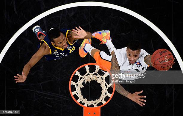 Brion Rush of Ulm is challenged by Alex Renfroe of Berlin during the Beko Basketball Bundesliga match between Ratiopharm Ulm and Alba Berlin at...