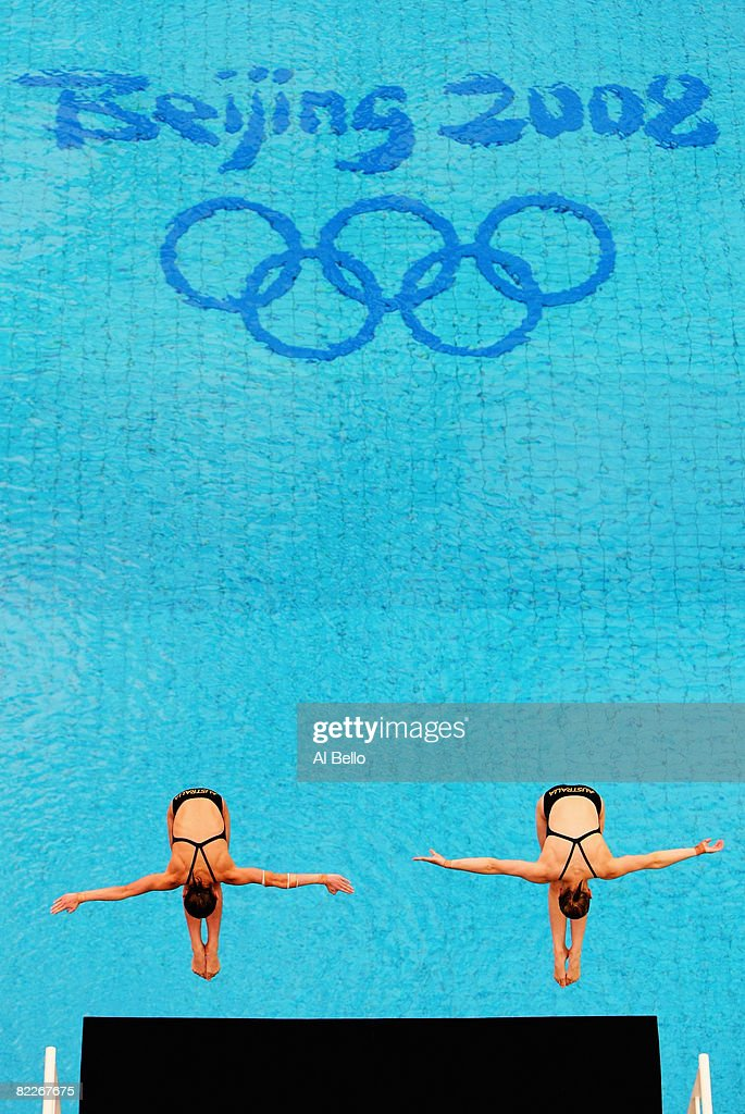 Briony Cole and Melissa Wu of Australia compete in the Women's Synchronised 10m Platform Final held at the National Aquatics Center during day 4 of...