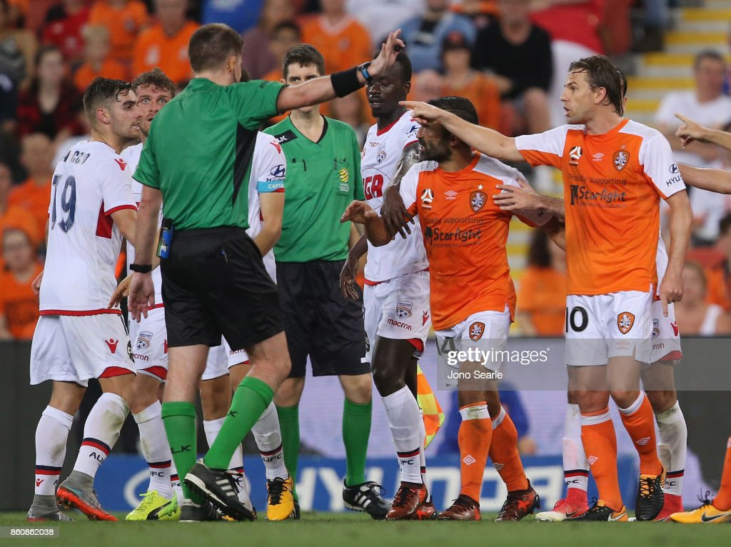 Brisbane and Adelaide teams argue with the referee during the round two A-League match between the Brisbane Roar and Adelaide United at Suncorp Stadium on October 13, 2017 in Brisbane, Australia.
