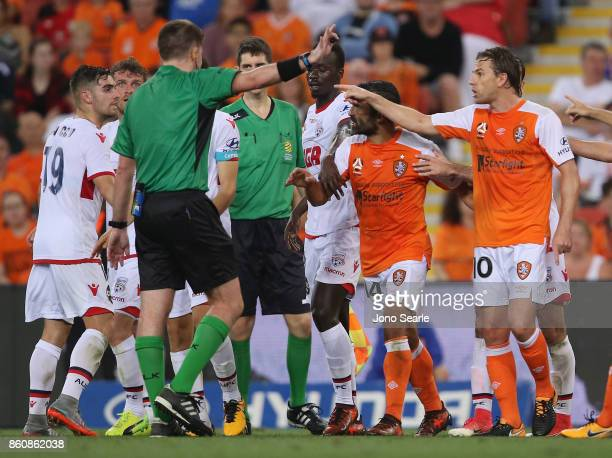 Brisbane and Adelaide teams argue with the referee during the round two ALeague match between the Brisbane Roar and Adelaide United at Suncorp...