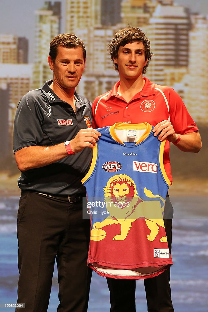Brisbane assistant coach Mark Harvey with new Lions recruit Sam Mayes during the 2012 AFL Draft at the Gold Coast Exhibition Centre on November 22, 2012 in Gold Coast, Australia.