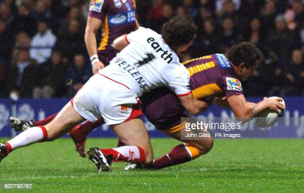 Brisbane Broncos' Corey Parker scores a try against St Helens during the Carnegie World Cup Challenge at the Reebok Stadium Bolton