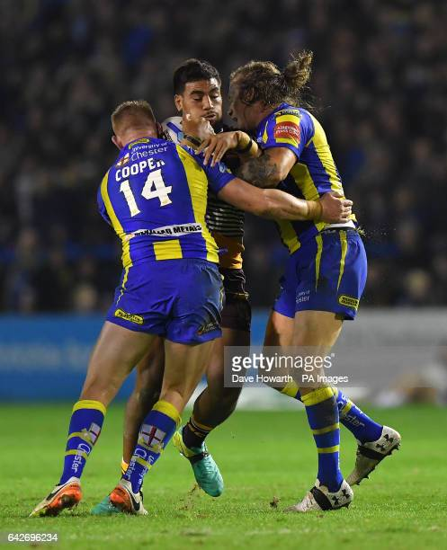Brisbane Broncos' Joe Ofahengaue is tackled by Warrington Wolves' Mike Cooper and Ashton Sims during the 2017 Dacia World Club Series match at the...
