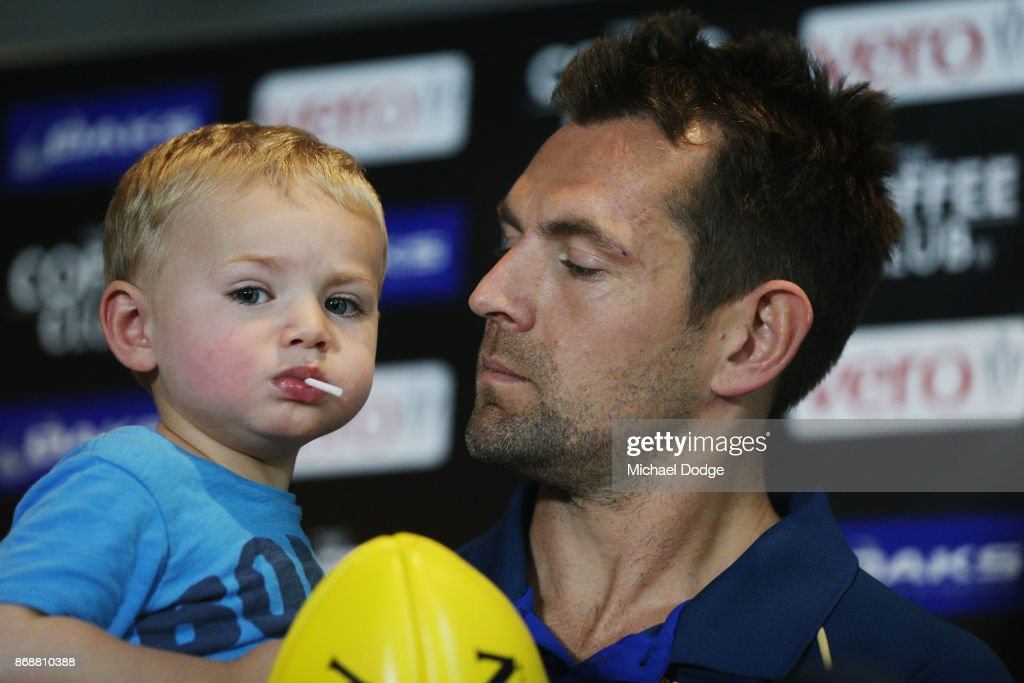 Brisbane Lions recruit Luke Hodge holds son Leo when speaking to media during a Brisbane Lions AFL media opportunity at WRAP on Southbank on November 1, 2017 in Melbourne, Australia.