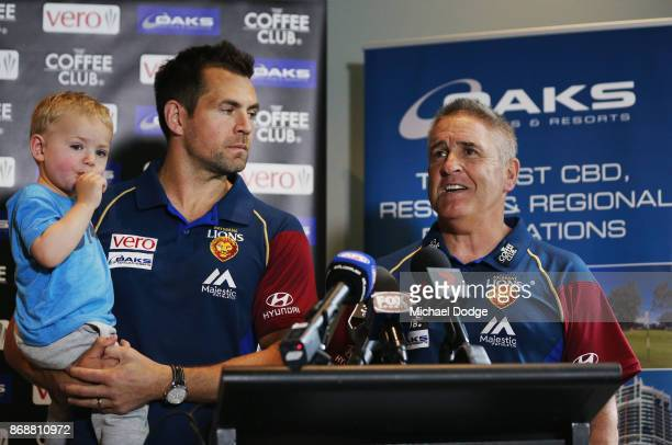 Brisbane Lions Senior Coach Chris Fagan and new recruit Luke Hodge with son Leo speak to the media during a Brisbane Lions AFL media opportunity at...