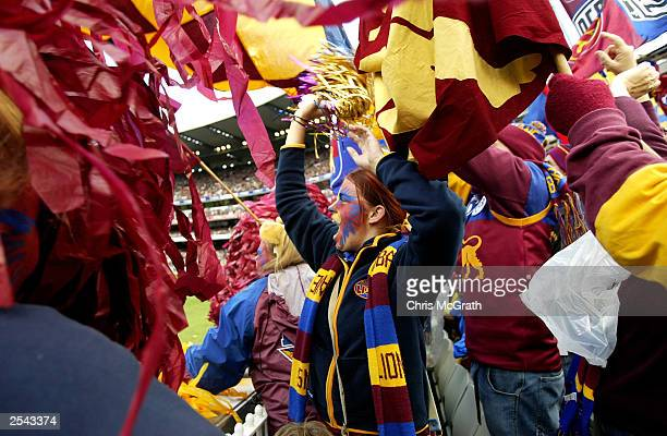 Brisbane Lions supporters celebrate a goal during the AFL Grand Final between the Collingwood Magpies and the Brisbane Lions at the Melbourne Cricket...