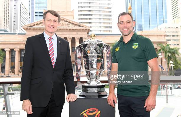 Brisbane Lord Mayor Graham Quirk and Australian captain Cameron Smith pose for a photo alongside the World Cup trophy during a Rugby League World Cup...