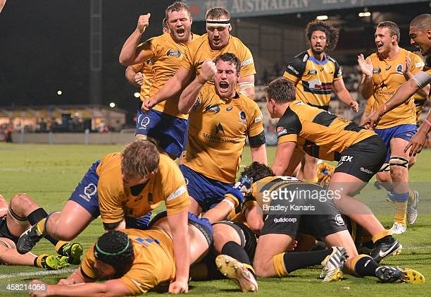 Brisbane players celebrate a try by Pettowa Paraka of Brisbane City during the 2014 NRC Grand Final match between Brisbane City and Perth Spirit at...
