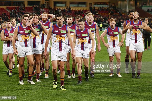 Brisbane players leave the field lead by captain Tom Rockliff after the round 20 AFL match between the Adelaide Crows and the Brisbane Lions at...