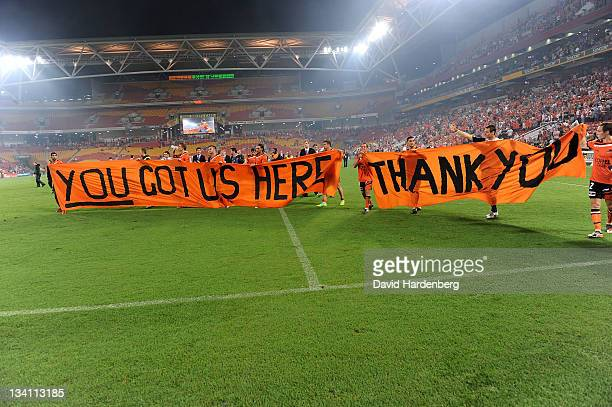 Brisbane Roar celebrate 36 wins during the round eight ALeague match between the Brisbane Roar and the Perth Glory at Suncorp Stadium on November 26...