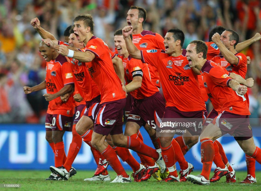 Brisbane Roar celebrate victory in the the ALeague Grand Final match between the Brisbane Roar and the Central Coast Mariners at Suncorp Stadium on...