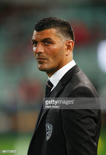 Brisbane Roar coach John Aloisi watches his team warm up before the round one ALeague match between the Western Sydney Wanderers and the Brisbane...
