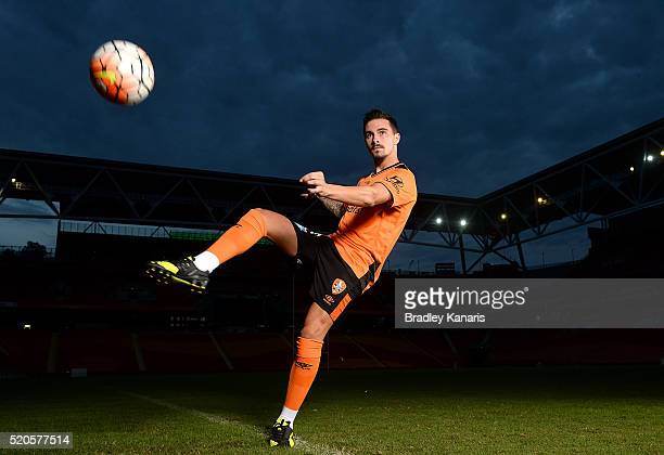 Brisbane Roar player Jamie Maclaren strikes the ball during a portrait session at Suncorp Stadium on April 12 2016 in Brisbane Australia