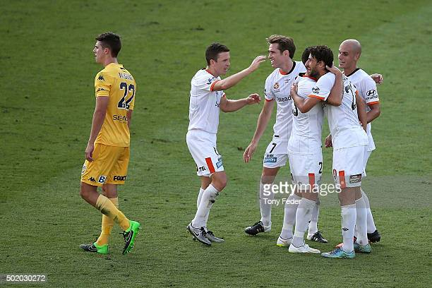 Brisbane Roar players celebrate a goal during the round 11 ALeague match between the Central Coast Mariners and the Brisbane Roar at Central Coast...