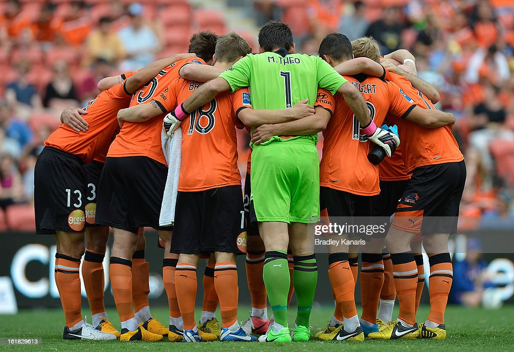 Brisbane Roar players embrace before the round 21 A-League match between the Brisbane Roar and the Wellington Phoenix at Suncorp Stadium on February 17, 2013 in Brisbane, Australia.