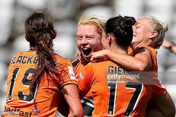 Brisbane Roar team mates celebrate a goal during the round 10 WLeague match between Sydney FC and Brisbane Roar at Central Coast Stadium on December...