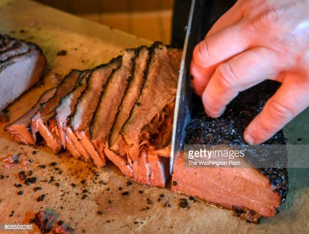Brisket being sliced at Hill Country BBQ for our Weekend cover story on DC's best barbecue on June 2017 in Washington DC