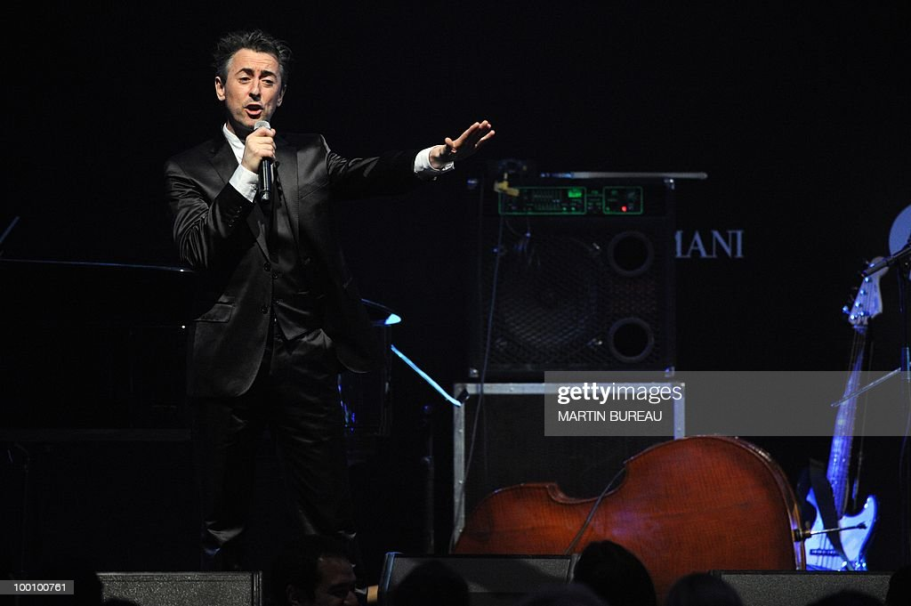 Bristish actor Alan Cumming leads an auction at amfAR's Cinema Against Aids 2010 benefit gala on May 20, 2010 in Antibes, southeastern France.