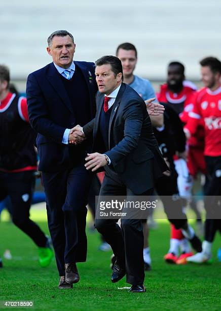 Bristol City manager Steve Cotterill is congratulated on their League title by Coventry manager Tony Mowbray as the run off the field after the Sky...