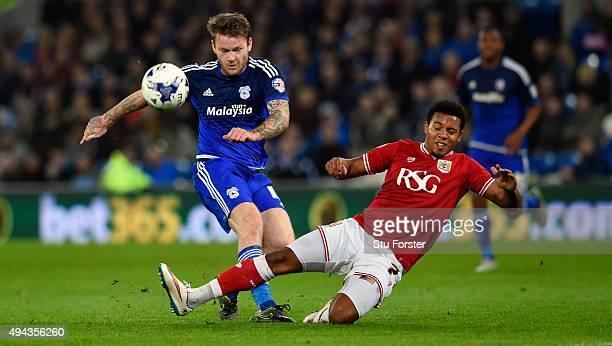 Bristol City player Korey Smith blocks the goalbound shot of Aron Gunnarsson of Cardiff during the Sky Bet Championship match between Cardiff City...