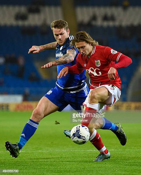 Bristol City player Luke Freeman holds off the challenge of Aaron Gunnarsson of Cardiff during the Sky Bet Championship match between Cardiff City...
