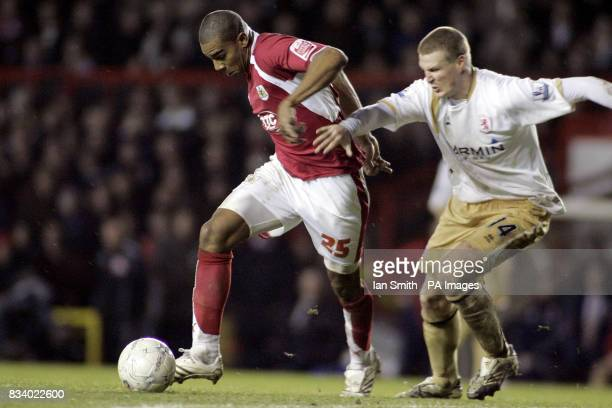 Bristol City 's Marvin Elliott in action with Middlesbrough's Robert Huth during the FA Cup third round match at Ashton Gate Stadium Bristol